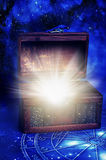 Magic box. A wooden magic box with rays of light like a concept of surprise, surprising gift, treasure, esoteric magic rituals Royalty Free Stock Images