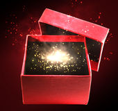 Magic box. Gift magic box on the red background Stock Photo