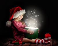 Magic box. Cute little girl opening a magic gift box Royalty Free Stock Image