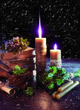 Magic candles with clover on black Royalty Free Stock Photo