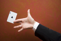 Magic card trick. The illusionist performing with card Stock Photography