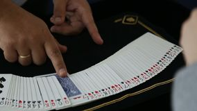 Magic, card tricks, gambling, casino, poker concept - man showing trick with playing cards. The person makes a choice stock video