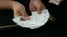 Magic, card tricks, gambling, casino, poker concept - man showing trick with playing cards. The person makes a choice stock video footage