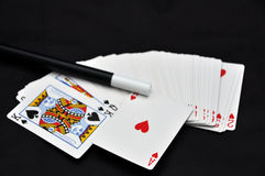 Playing cards and magic wand Royalty Free Stock Photography