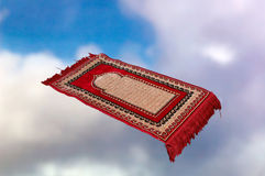 Magic carpet in the clouds. A flying magic carpet is high in the clouds. What it will be seen carrying  is up to you Royalty Free Stock Images