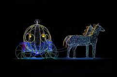 Magic Carriage for Cinderella. Cinderellas carriage made of festive illumination isolated on black background Royalty Free Stock Images