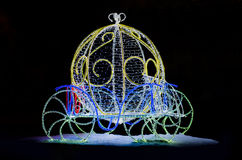 Magic Carriage for Cinderella. Cinderellas carriage made of festive illumination isolated on black background Royalty Free Stock Photography