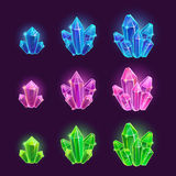 Magic cartoon shiny crystals set. Elements on the dark background Stock Images