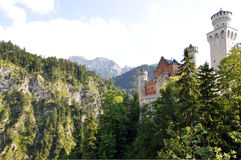 Magic Castle. Beautifully located in the Bavarian Alps, there is the famous fairy tale castle Neuschwanstein royalty free stock photography