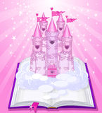 Magic castle appearing from the book. Fairy tale castle appearing from the old book Royalty Free Stock Image