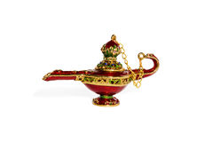 Magic ceramic lamp of Aladdin. Red ceramic Aladdin magic lamp with a cover on a chain isolated on a white background royalty free stock photo