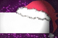 Magic Christmas. Magical Christmas card with snow Santa's hat and place for your text Stock Photo