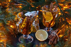 Magic Christmas background - vintage wood, candy cane, house, cinnamon, star anise, sweet mandarins. New Year. royalty free stock photography