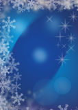 Magic christmas blue background. With white snowflakes and stars Stock Photography