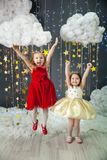 Girls in a studio with a gold stars decor Royalty Free Stock Photo