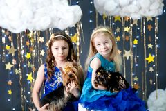 Girls in a studio with a gold stars decor Royalty Free Stock Photography