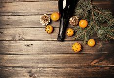 Christmas New Year composition with tangerines and pine cones. Magic Christmas composition. Champagne and tangerins Stock Photos