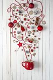 Magic Christmas cup with decorations and sweets on white wooden Stock Image