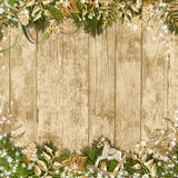 Magic Christmas garland on a wooden background. With beautiful decorations Stock Image