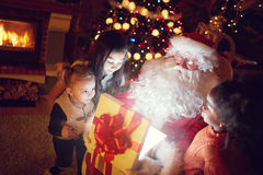 Magic of Christmas. Happiness group of children looking in magic Christmas present stock images
