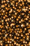 Magic Christmas Lights. Golden Magic Christmas Lights Blurry Closeup Stock Photography