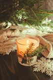 Christmas candle. Magic christmas mood with burning candle and glittering christmas tree lights stock photos