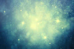 Magic Christmas and New Year Holidays night sky background. Magic Christmas and New Year Holidays night sky light with stars and snowflakes. Beautiful blue and Royalty Free Stock Photos