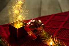 Magic Christmas Present. On red scarf with lights Royalty Free Stock Photos
