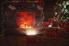 Magic Christmas present at the Christmas tree and fireplace Stock Photo