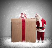 Magic Christmas. With Santa Claus with a big gift Royalty Free Stock Photo