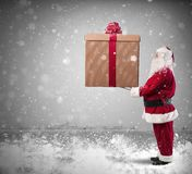 Magic Christmas. With Santa Claus with a big gift Royalty Free Stock Image