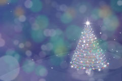 Magic Christmas tree background illustration with colorful bokeh Stock Images