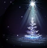 The Magic Christmas Tree in spotlight Royalty Free Stock Photos