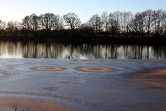 Magic circles at lake Einfelder See. Magic circles lake Einfelder See in winter Royalty Free Stock Photo