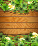 Magic clover on wooden background Royalty Free Stock Images