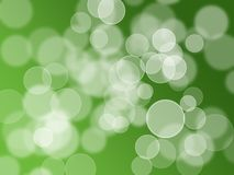 Magic color bokeh on green Stock Images