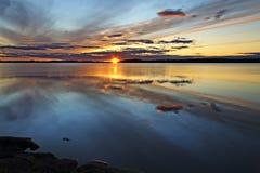 Magic colors of the sunset. Lake Pongomozero, North Karelia, Russia Royalty Free Stock Image