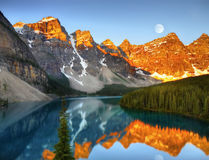 Magic Colours of Landscape. Magic yellow-orange-red colours of landscape by sunrise. Moraine Lake in Banff National Park, Canada