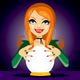 Magic Crystal Ball Fortune Teller. Beautiful red haired fortune teller woman reading future on magical crystal ball Stock Photo