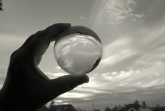 In the magic crystal ball watching the autumn sky royalty free stock photography