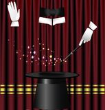 Magic curtain. Against the background of red theater curtain big hat magician, two hands in white gloves and a magic wand which creates a spell Royalty Free Stock Photo