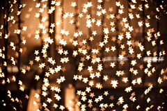 Magic defocused sparkly gold stars Stock Photography