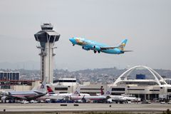Magic of Disneyland Boeing 737-400. LOS ANGELES, CALIFORNIA, USA - APRIL 24, 2012. An Alaska Airlines Magic of Disneyland 737-400 takes off from Los Angeles stock photo