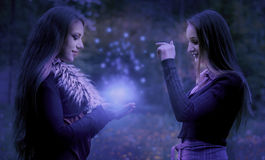Magic dust. Two young girls playing with magic dust stock photos