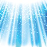 Magic flash of light on a blue background Royalty Free Stock Photos