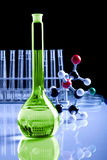 Magic Fluid. Laboratory flask witch green fluid placed in laboratory Stock Images