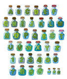 Magic font. Green letters in  magical flasks. Alphabet jar for w Royalty Free Stock Photography