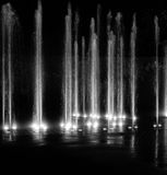 Magic fountain light and water show in black and white Royalty Free Stock Image