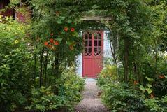 Magic Garden Entrance. Lush green garden in front of building entrance royalty free stock photography