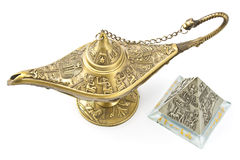 Magic genie  lamp and brass pyramid Royalty Free Stock Photo